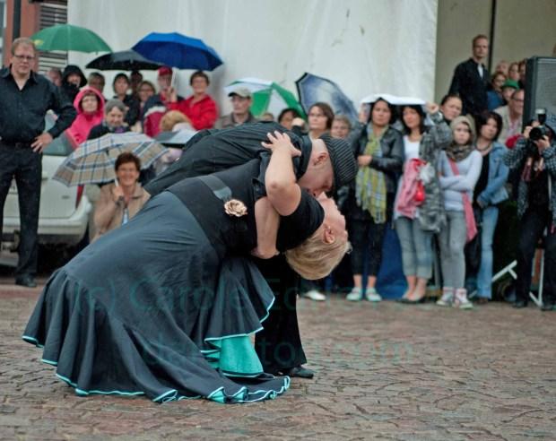 competitors performing the tango cliche in the rain