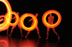 Dancers swinging torches
