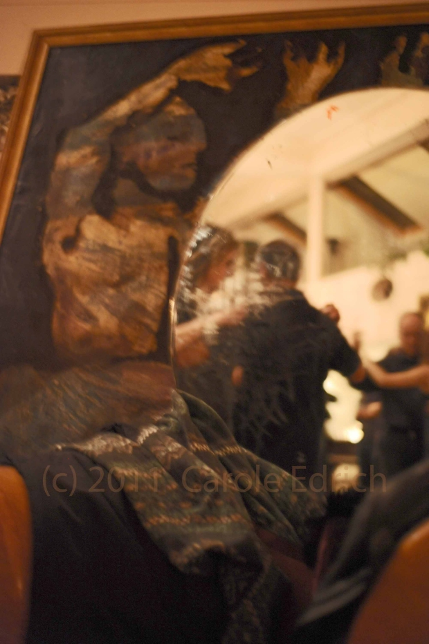 tango dancers reflected and framed in mirror