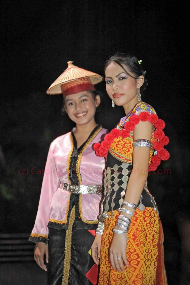ladies from two Sarawakian tribes, dressed and ready to perform their respective traditional dances