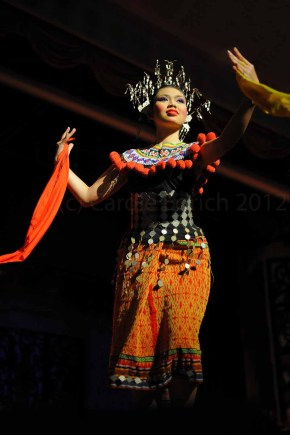Iban lady dancing with silk scarves