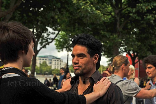 The teacher demonstrates how to lead and follow at Tango Walk on the South Bank