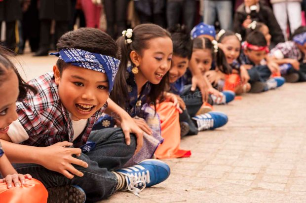 Children dancing for the Malaysian Minister of Tourism at London's South Bank