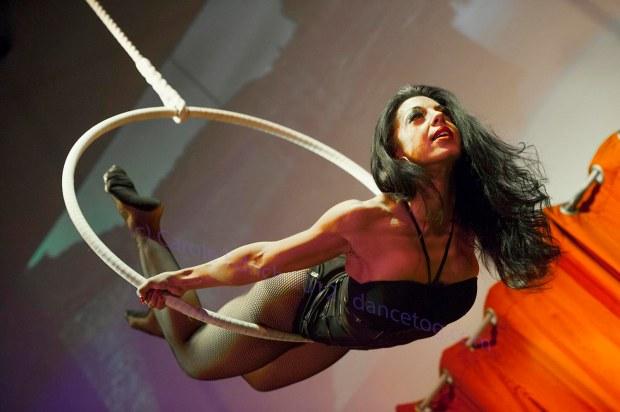 Hoop performer Allie Ho Chee performing at Milo Miles' Tainted Virtue