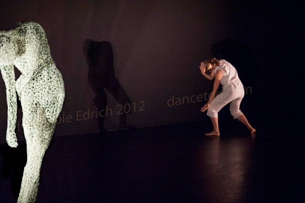 Yolande Yorke-Edgell dancing as Marilyn at the Lilian Baylis Theatre with shadow and sculpture visible
