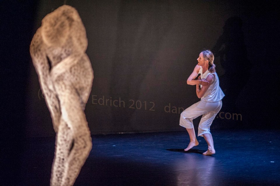 Yolande Yorke-Edgell dancing as Marylin Monroe in Noted with a sculpture by Sally McKay