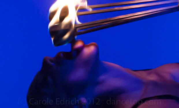 Allie Ho Chee dancing with fire at Milo Miles' Tainted Virtue in London