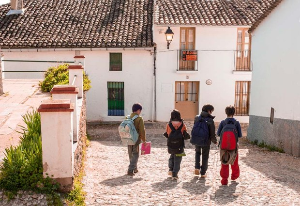 Children going home at lunchtime in Almonaster la Real, Huelva, Spain. (c) Carole Edrich 2013