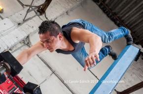 Felipe performing acrobalance at Brad's VW Garage in Wanstead, (c) Carole Edrich 2013