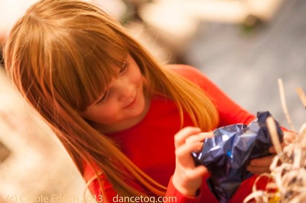 Child opening present (c) Carole Edrich 2013