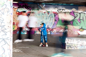 I used motion blur here to show how the little boy in blue might feel.