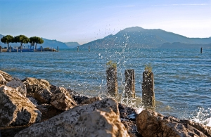 In this shot of the waves on Lake Garda I've used my camera settings to tell a story of the splashing waves.