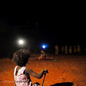 I used a large aperture to bring attention to the child in the front in this shot of Aboriginal Australians dancing at a festival in the outback.