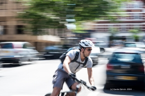 Cyclist turning a corner in central London, a shot I took during class to demonstrate the technique of panning to my students.