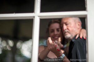 Milonga Gratis 2014. Depth of field and framing through the bandstand windows turn a tango cliche into an intriguing story.