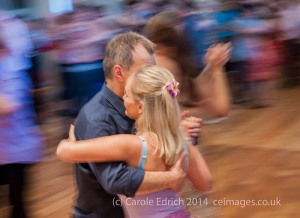 Encuentro Una Mirada 2014. Panning combined with the high ISO necessary for low light photography isolates this dancing couple, making the shot more romantic.