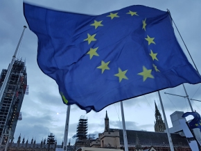 Eu Flag with houses of parliament in background