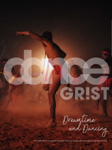 The image is in the dusty reddy browns of desert at night. A group of traditional tribal dancers with loincloths are stamping barefoot into the desert ground. They are lit by a single source of light that id diretly behind the dancer in the ftont. Overlaid on this is a white logo of dance grist, where the 'i' in grist is represented by an exclamation mark. The magazine's title is dreamtime and dancing