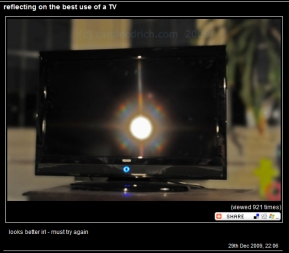 Dark TV screen with rainbow colours around the reflection of a light source, (c) Carole Edrich 2009